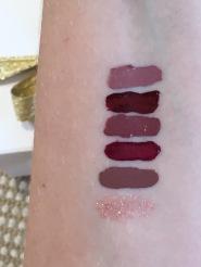Baci (nude pink) Rubino (beet red) Fresco (mid tone dusty rose) Patina (dusty rose) Bacca (raspberry) Glitterati Lip Top Coat in Transcend (multi-colour sparkle)